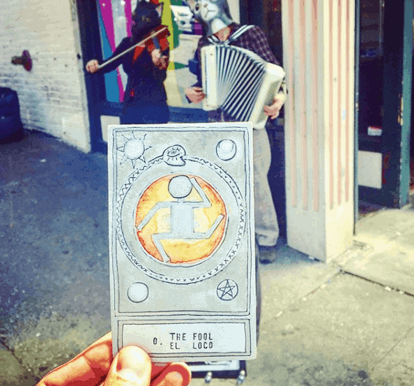 tarot card in front of a storefront outdoors