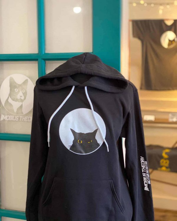 black hoodie with cat graphic on a mannequin