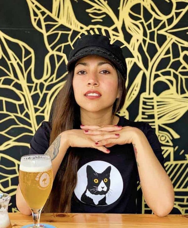 female model wearing graphic t-shirt in a restaurant