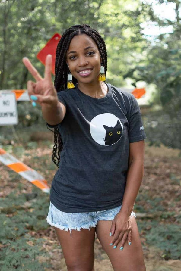 female model wearing graphic t-shirt outdoors