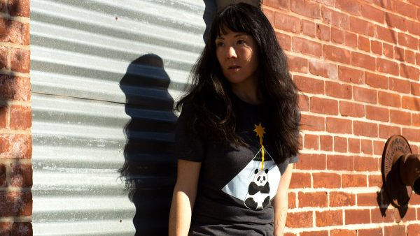 female model wearing black graphic tee