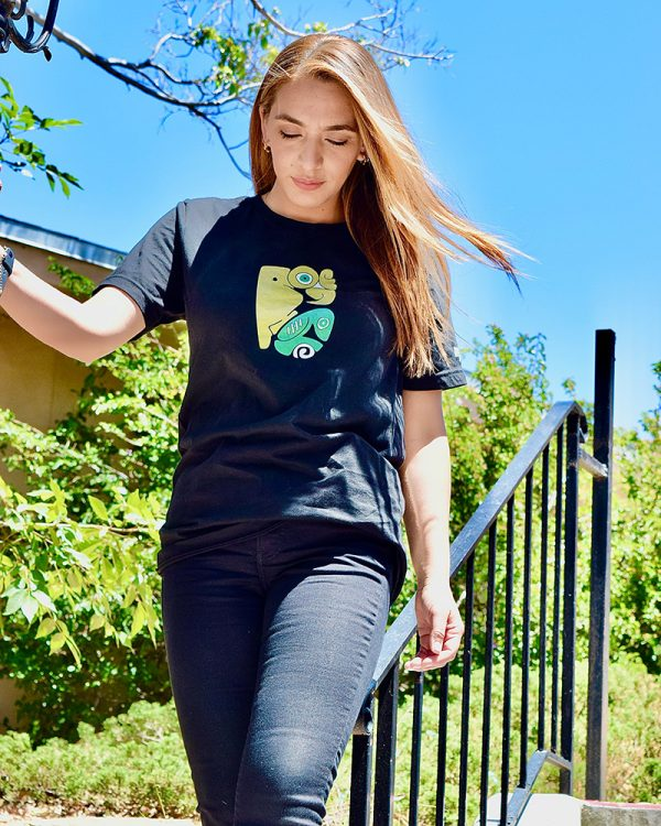 female model wearing black graphic tee outdoors