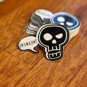 cursing skull sticker on wood background